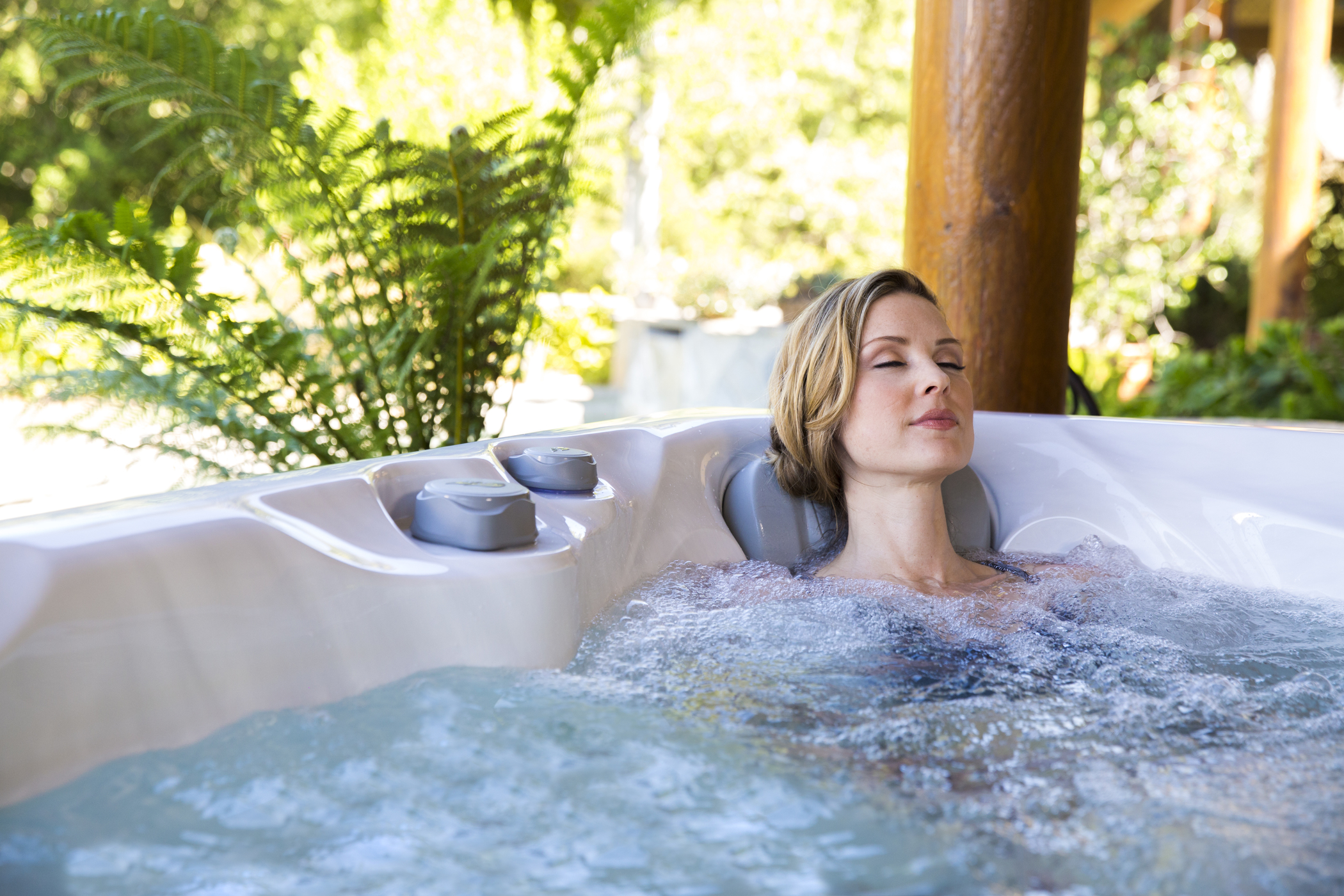Woman relaxing in hot tub.