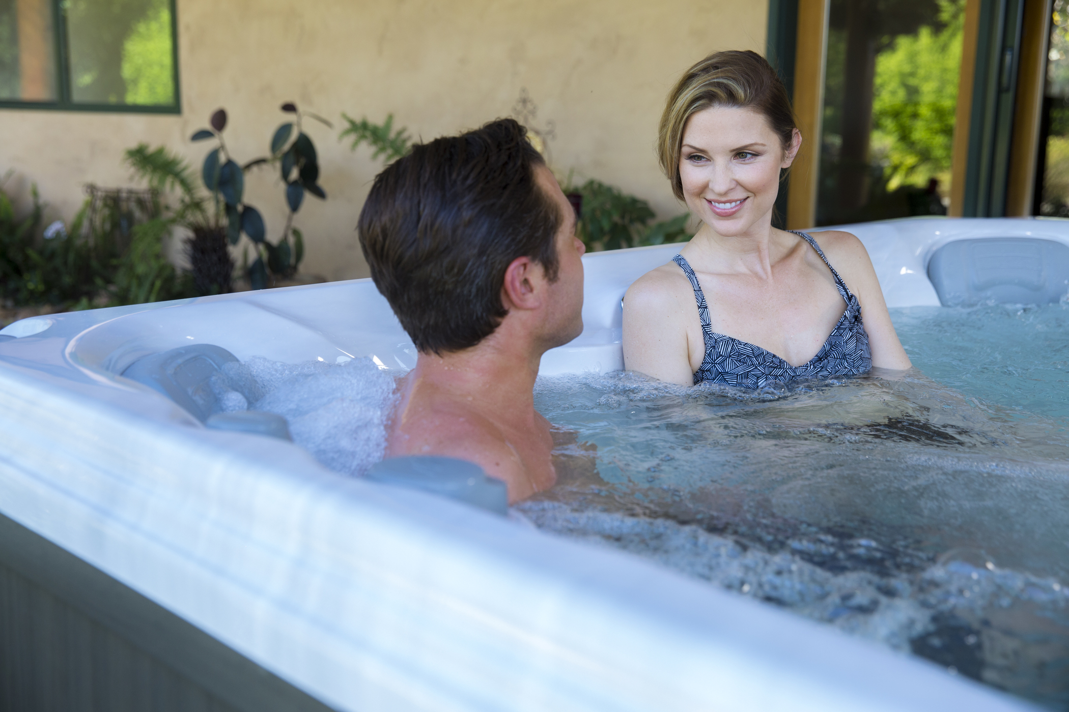 Man and woman relaxing in a hot tub.