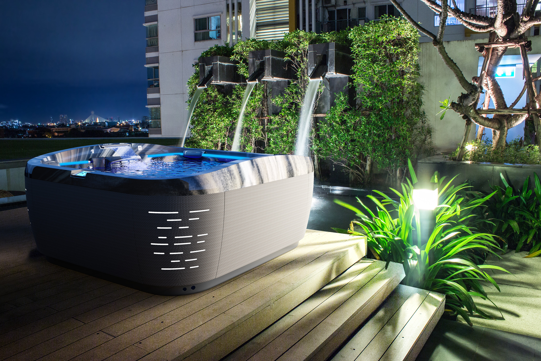 Outdoor hot tub installation at night.